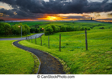 pathway leading into sunset