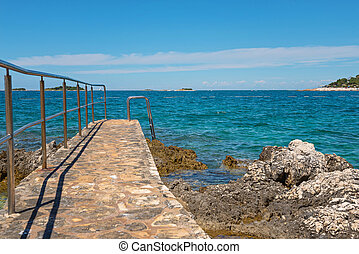 Pathway on the rocky beach in Istria