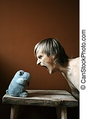 patience - angry man and his hippo toy