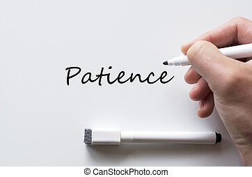 Patience written on whiteboard - Human hand writing patience...