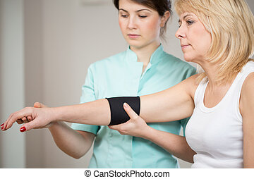Patient after injury during rehabilitation - Blonde female...