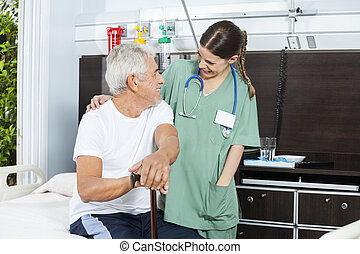 Patient And Nurse Looking At Each Other In Rehab Center