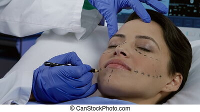 Patient and surgeon during a cosmetic procedure