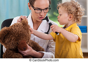 Patient at play - Patient playing with a teddy bear at ...