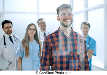 Patient at the hospital with doctors on the background