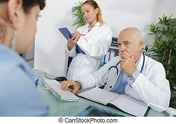 patient consulting a senior doctor in the hospital