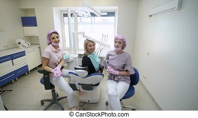 Patient, dentist doctor and assistant in dental clinic