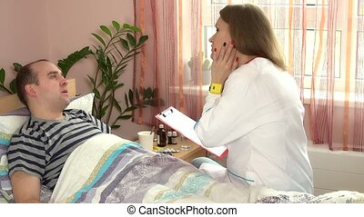 Patient examination in hospital. Doctor woman and man lying in bed.