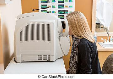 Patient Going Through Eye Examination In Store