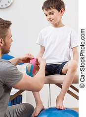Patient having applied kinesiology tapes