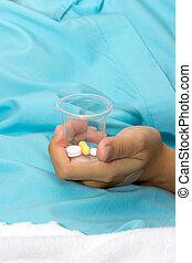 Patient hold the pill in bottle