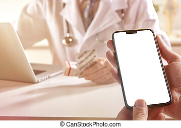 Patient holding a mobile in the office of a doctor