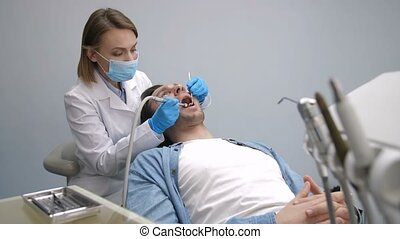 Patient in dental chair getting teeth treatment