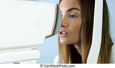 patient in ophthalmology clinic during the study of computer...