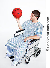 Patient in wheelchair with a basket ball