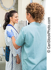 Patient Looking At Nurse Before Getting Chest Xray