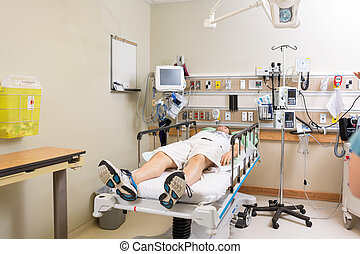 Patient Lying On Bed In Hospital Room