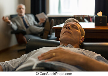 Patient lying on the couch with eyes closed