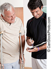 Patient on Crutches and Physician - Patient on crutches ...