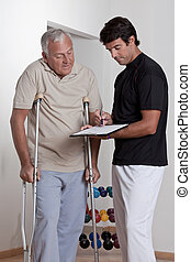 Patient on Crutches and Physician - Patient on crutches...