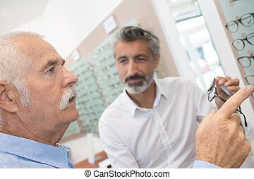 patient pointing at the eyeglasses frame