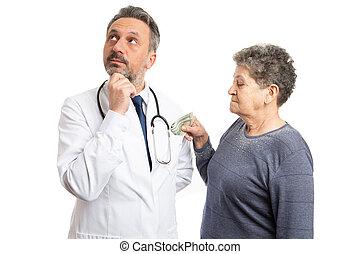 Patient putting money inside pocket of doctor