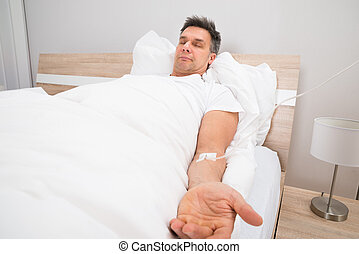 Patient Resting On Bed With Iv Drip