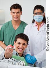 Patient showing dental molds