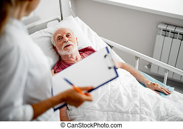 Patient talking with doctor while lying in bed