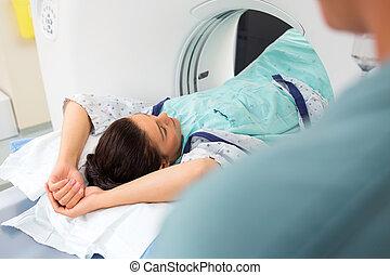 Patient Undergoing CT Scan - Female patient undergoing CT...