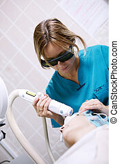 Patient undergoing skin treatment with a laser - Patient...
