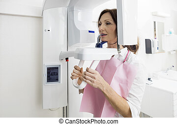 Patient Using Panoramic Xray Machine In Clinic