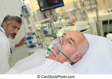 patient wearing an oxygen mask