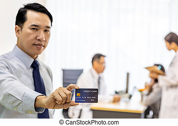 Patient with credit card for insurance concept