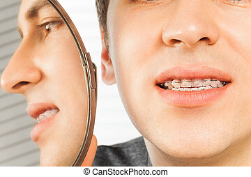 Patient with dental braces in dentist office