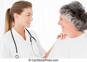 Patient with her nurse smiling