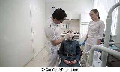 Patient woman at dentist orthopedic