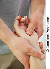 Patients hand being massaged by physiotherapist