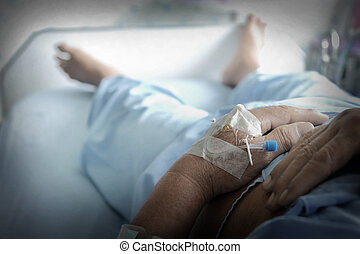 Patient's hand with iv solution set.