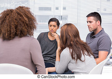 Patients listening to another patient during therapy session