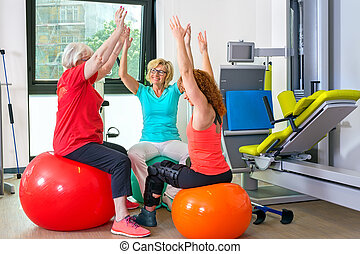 Patients on stability balls doing exercises