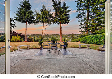 Patio area with scenic view during sunset