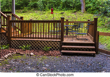 Patio Deck - Wooden patio deck with furniture at cabin in...