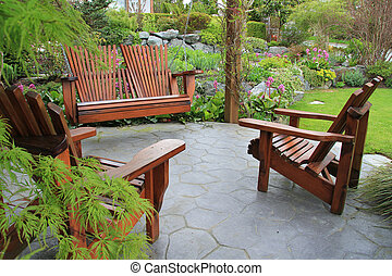 Patio furniture in the garden. - Adirondack wooden chairs on...