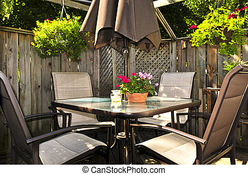 Patio furniture on a deck - Wooden deck of a house with ...