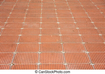 beautiful patio of square red brick clay tile floor with rough pattern style