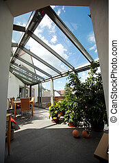 Patio With Furniture And Plants In It - View of patio ...