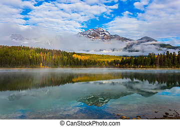 Patricia Lake among the firs and pines. The water reflects ...