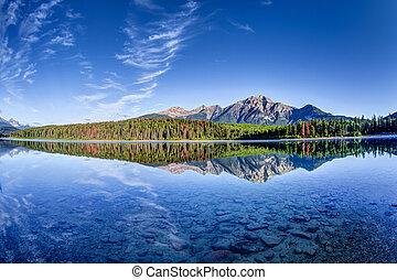 Patricia Lake at Jasper, Alberta - Colorful trees lined the...