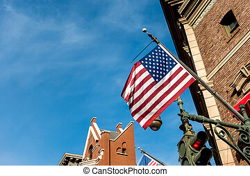 Patriotic American flag in beautiful pole placed on the wall